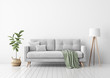 Living room interior with gray velvet sofa, pillows, green plaid, lamp and fiddle leaf tree in wicker basket on white wall background. 3D rendering.