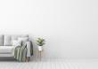 Leinwandbild Motiv Living room interior with gray velvet sofa, pillows, green plaid, lamp and fiddle leaf tree in wicker basket on white wall background. 3D rendering.