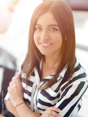 Young businesswoman sitting at desk in office