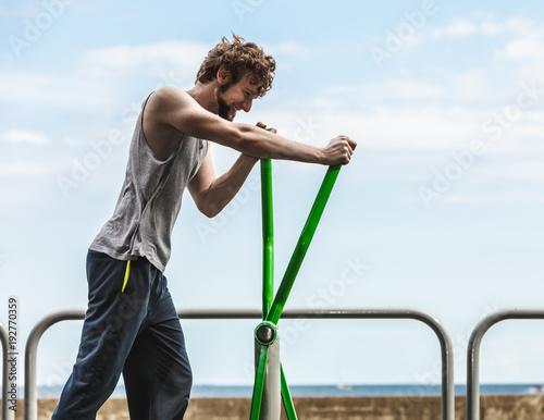 Aluminium Fitness Active man exercising on elliptical trainer.