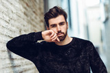 Young bearded man, model of fashion, in urban background wearing casual clothes. - 192794300