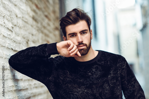 Foto Murales Young bearded man, model of fashion, in urban background wearing casual clothes.