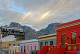 Colorful outdoor street and city photo of buildings in Bo Kaap, Cape Town, South Africa during sunset with the table mountain in the background - 192795153