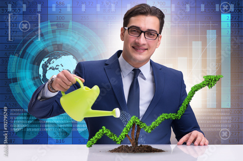 Foto Murales Businessman in investment concept watering financial line chart