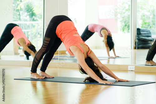 Plakat Young asian women practicing yoga, fitness stretching flexibility pose, working out, healthy lifestyle, wellness, well being
