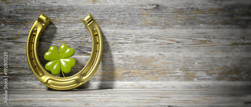 St Patrick's four leaf clover and horseshoe on wooden background, banner, copy space. 3d illustration