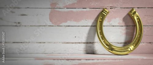 Golden horseshoe on wooden background. Copy space. 3d illustration