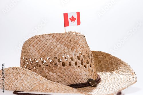Keuken foto achterwand Canada Fashionable cowboy hat for a man with small flag of canada