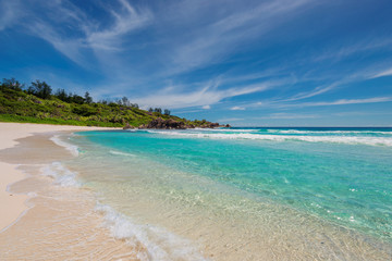 Sandy beach with turquoise sea on Paradise island.
