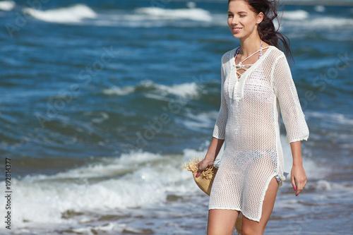 woman enjoying a walk on the beach