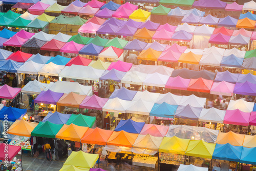 Foto op Plexiglas Bangkok Top of walking night market multiple colour, cityscape background