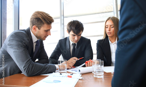 Wall mural Business meeting in an office, the businesspeople are discussing a document.