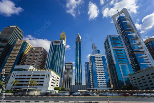 Tuinposter Dubai View on skyscrapers in Financial center of Dubai, United Arab Emirates