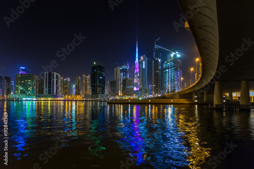 Foto op Aluminium Dubai Panoramic view of business bay and downtown area of Dubai, reflection of night illumination of skyscrapers in Dubai creek. UAE