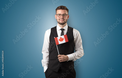 Keuken foto achterwand Canada Handsome student standing with national flag
