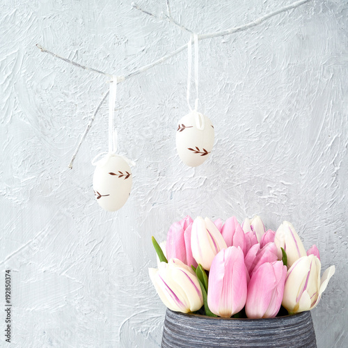Easter background with eggs and pink tulips. Holiday card with copy space.