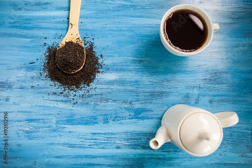 Top view of a cup with tea on vintage blue background