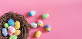 Colorful easter egg and nest on pink pastel color background with space. - 192854390