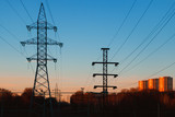 High voltage power lines in an urban environment on the background of sunset - 192856900