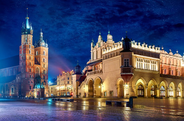 Saint Mary's Basilica in Krakow Poland with Cloth Hall at main