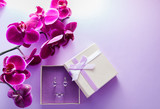 Silver earrings with amethyst in the gift box with orchid