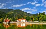 Beautiful landscape of Tusnad spa resort architecture reflected in Saint Ana lake in Romania - 192868546