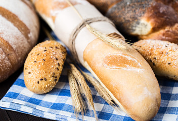 Fresh bread on table. Homemade bread. Kitchen or bakery poster design. Bread background