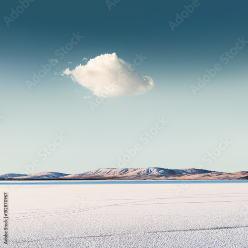 Cloud over a frozen lake. Beautiful winter landscape - 192870967