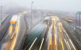 morning, intensive traffic on the urban road thoroughfare in difficult road conditions, fog and darkness - 192871312