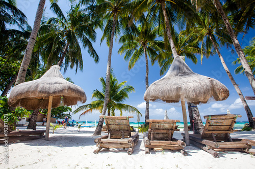 Chaise longues and hammock at the beach on the Boracay island, Philippines