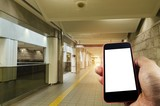 hand using smart phone isolated blank screen with blurred image of subway at railway station, lifestyle, transportation, technology, internet, network connection, social media, advertisement concept - 192874109