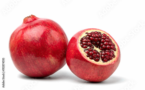 Foto Murales Ripe pomegranate fruit on white background cutout