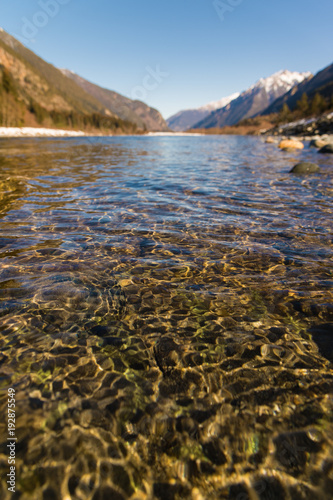 Fotobehang Bergrivier Midday Autumn landscape calm river in the Caucasus Mountains with rocks in the near term