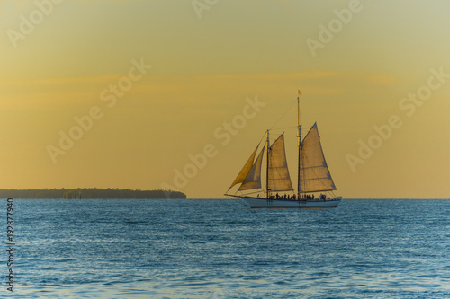 Fotobehang Zeilen USA, Florida, Majestic sailing ship on the ocean at sunset time near key west