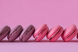 Pink and purple macaroons on pink - 192879512
