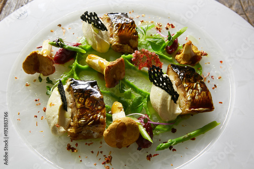 Grilled Foods. Grilled Fish with chanterelles with greens. - 192883766