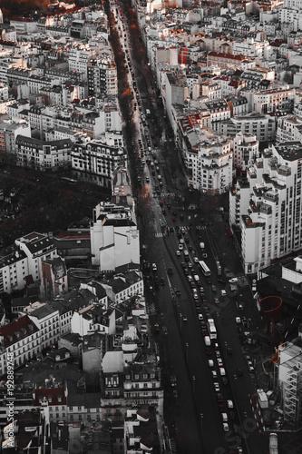 Poster Parijs Parigi vista dall'alto di un grattacielo al tramontoi