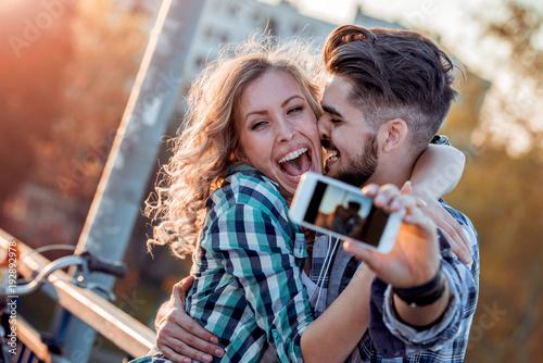 Loving couple take selfie in the city.