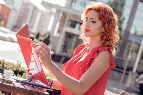 Fototapeta Beautiful young businesswoman in the cafe.