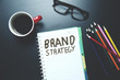 brand strategy text on notepad