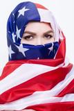 beautiful Sirian woman wearing a hijab from the American flag - 192899315