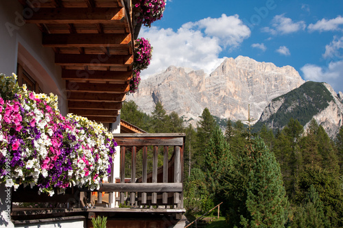 Poster Cappuccino Landscape view with flower balcony of Unesco World Heritage site Dolomiti, Alta Badia, Italy