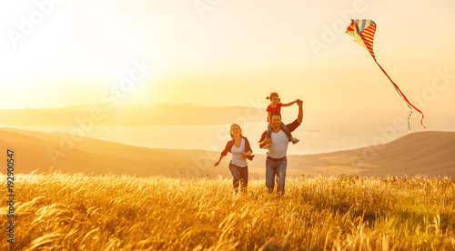happy-family-father-of-mother-and-child-daughter-launch-a-kite-on-nature-at-sunset