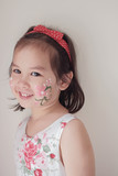 Cute Asian girl with flower face painted - 192912369