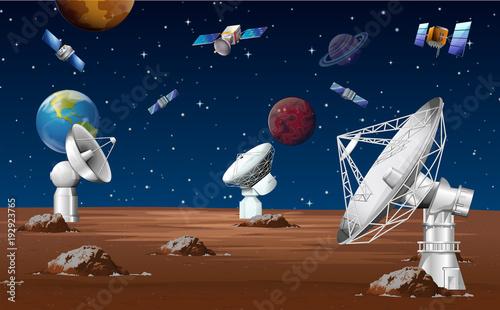 Fototapeta Satellites orbitting around the planet