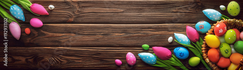 Easter Eggs and Decorative Tulips on Dark Wooden Background - 192931102