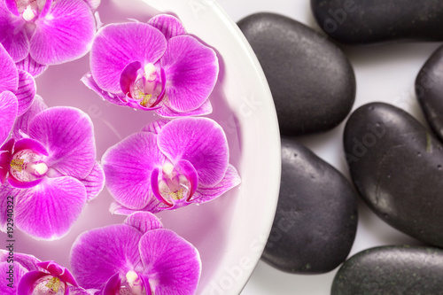 Leinwanddruck Bild zen stone and orchid. spa concept
