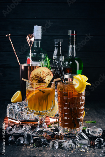 Two popular cocktails with ice. Long island On a black wooden background.