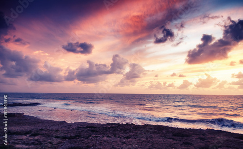 Foto op Aluminium Zee zonsondergang fantastic stunning colorful landscape, sunset on the shore of the blue sea, the coast of Cyprus, the neighborhood of Paphos