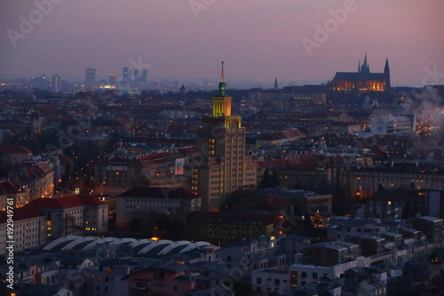 Foto op Aluminium Praag Evening cityscape if the Prague with lit houses and Castle